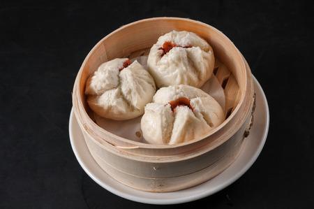 Steamed bun stuffed with barbecued roast pork; cha siu sou