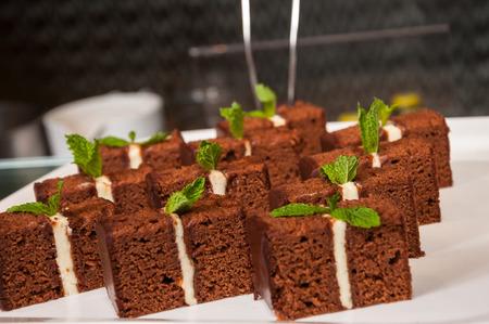 Chocolate brownie with mint leaf Stock fotó
