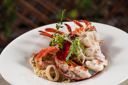 baked lobster with seafood and noodles