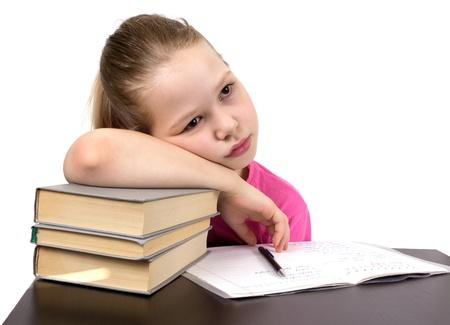 The schoolgirl does homework photo