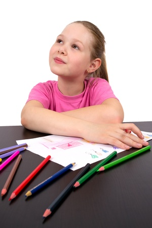 The girl draws a picture color pencils photo