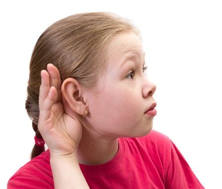 Little Girl Holding Hand on Ear