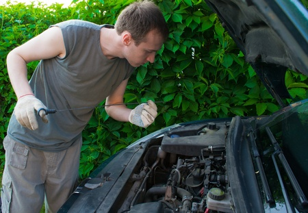 The man repairs the car Stock Photo - 9730638