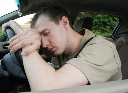 tired businessman: man sleep in a car