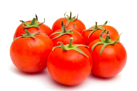 delightfully: red tomatoes isolated on a Stock Photo