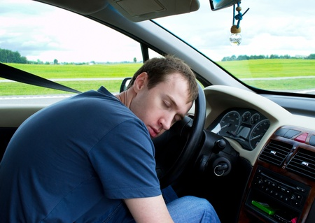 sleepy: Young man sleeps in car