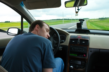 sleepy: The man sleeps in the car