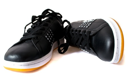 Black trainers with a yellow sole photo