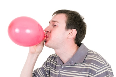 man inflating red balloon Stock Photo - 9961238