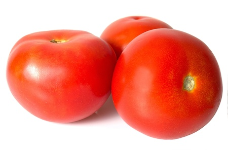 Red tomatoes isolated on a white background photo