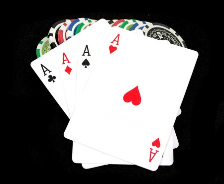 Cards and ultimate poker chips on black Stock Photo - 9961629