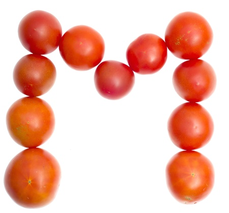 delightfully: The symbol M from red ripe tomatoes on white Stock Photo