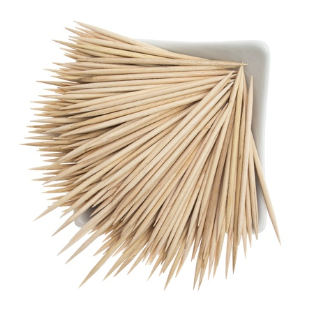 Wooden toothpicks on a white background photo