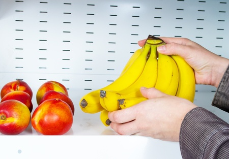 hands take bananas from store shelves Stock Photo - 10369456