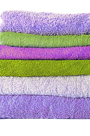 terry: Different shades of towels stacked on each other Stock Photo