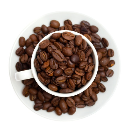 winnower: coffee beans in a cup isolated on white background