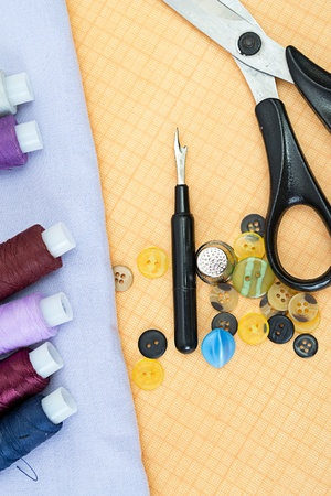 Sewing supplies: thread, scissors, buttons photo