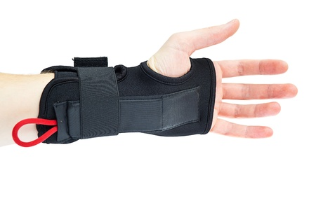 elbow brace: Wrist support with hand isolated on white.