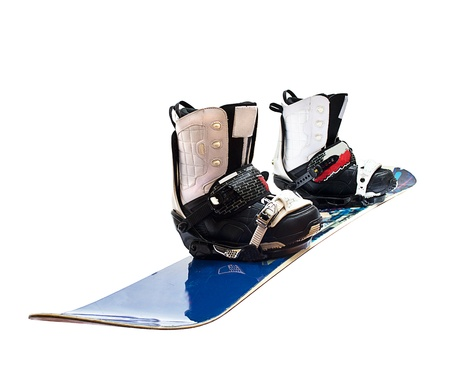 snowboard and boots isolated on white photo