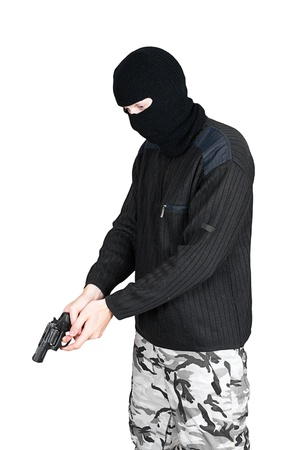 man in a mask with a gun on a white background photo