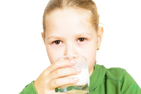 non alcoholic: Little girl with milk isolated on white background Stock Photo