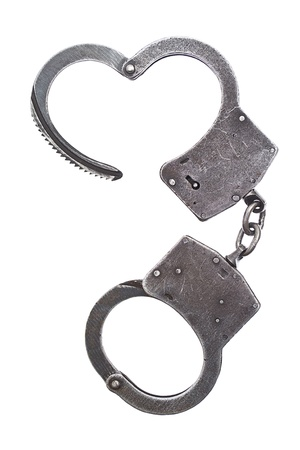 lockup: Metal handcuffs for hands on a white background Stock Photo