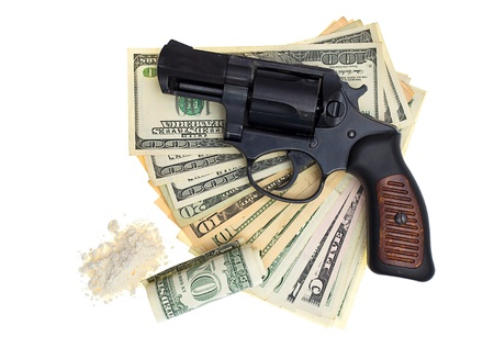 snitches: handcuffs, gun and money isolated on a white background Stock Photo