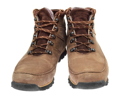 A pair of new boots on white background photo