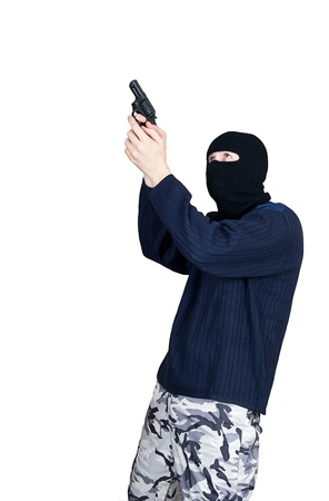 Masked man aims with gun photo