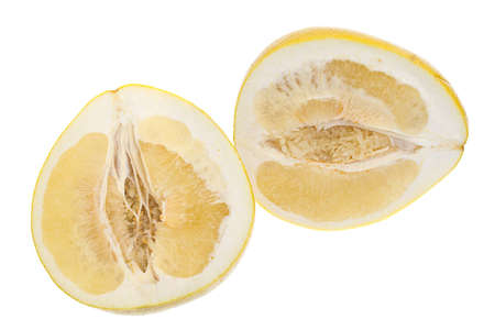 Cut a large yellow honey pomelo on white background photo