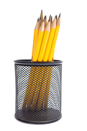 Pencils in pencil holders isolated photo