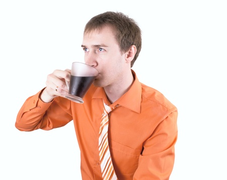 Young man drinking coffee on a white. Stock Photo - 12833315