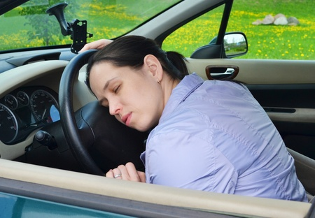 Young girl sleeps in her car  photo