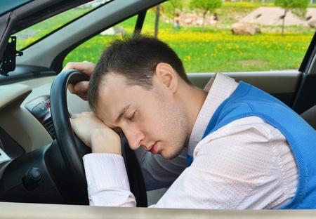Man sleeps in a car  photo
