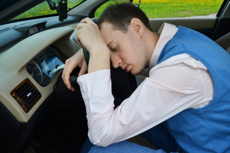 Man sleeps in a car. photo