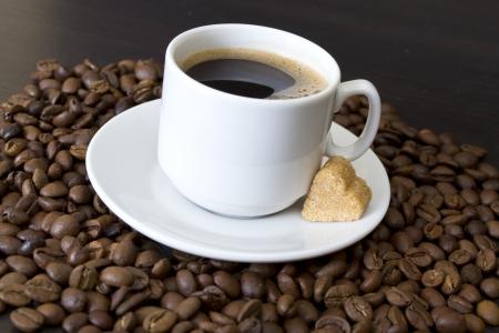 coffee beans, cup, Pots, cinnamon on dark background Stock Photo - 16942422