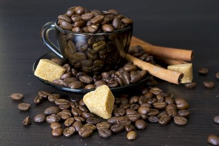 winnower: coffee beans, cup, Pots, cinnamon on dark background