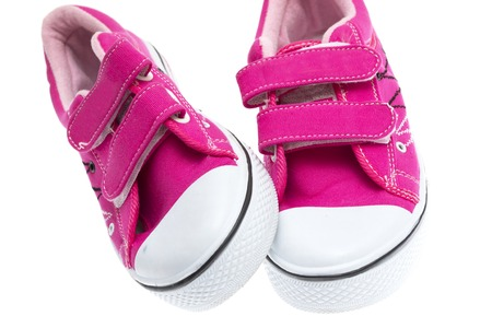 Pink sneakers isolated on white background photo