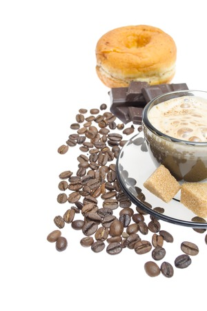 Cappuccino, brown sugar and coffee beans on white  photo