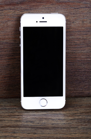 founders: Minsk, Belarus - April 16, 2016: Apple iPhone 5, 5S. White version. Front view. The operating system iOS 9. The founders of the company: Steve Jobs, Ronald Wayne, Steve Wozniak. Apple Inc. Located in USA.