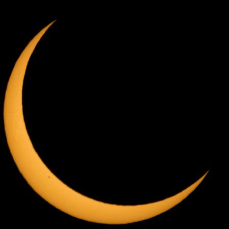 Crescent sun during a solar eclipse