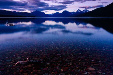 Colorfull peebles stone lake McDonald shore