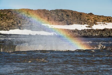 Rainbow over selfoss waterfall brink