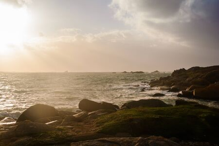 Britany coast by stormy sunset