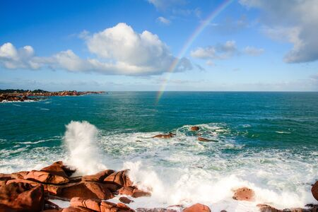 Rainbow over the pink granite coast in Britany