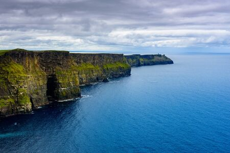 Blue sea at the foot of Moher cliffs