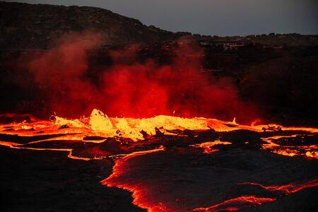 Waves of lava at the surface of Erta Ale lava lake Foto de archivo