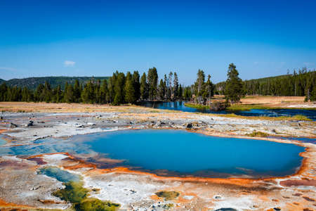 Blue hot pool in Biscuit basin in Yellowstone