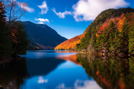 Reflection of fall color on Lower Ausable Lake