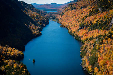 Blue water and fall color of Lower Ausable Lake Banco de Imagens